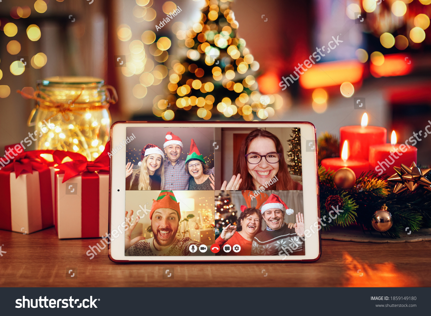 Christmas video call with the family. Concept of families in quarantine during Christmas because of the coronavirus. Xmas still life with a tablet in a cozy room #1859149180