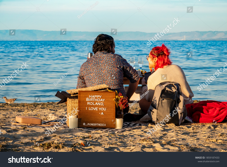 stock-photo-monterey-california-november-a-couple-enjoys-a-catered-outdoor-dining-romantic-1859187433.jpg