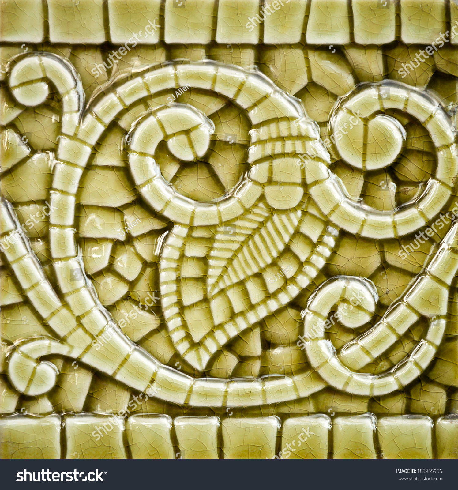 Old heritage art nouveau imitation mosaic stock photo royalty free old heritage art nouveau imitation mosaic ceramic tile in an olive color with a vine and dailygadgetfo Images