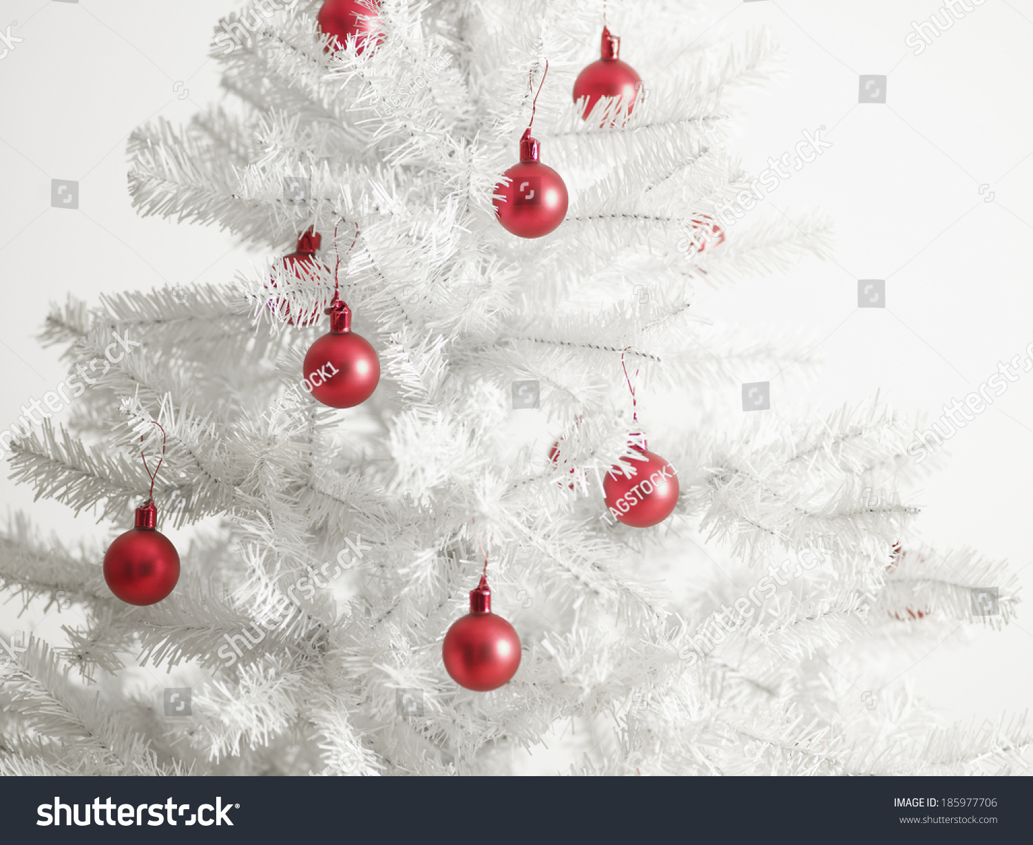 White christmas tree red baubles stock photo 185977706 for White christmas baubles