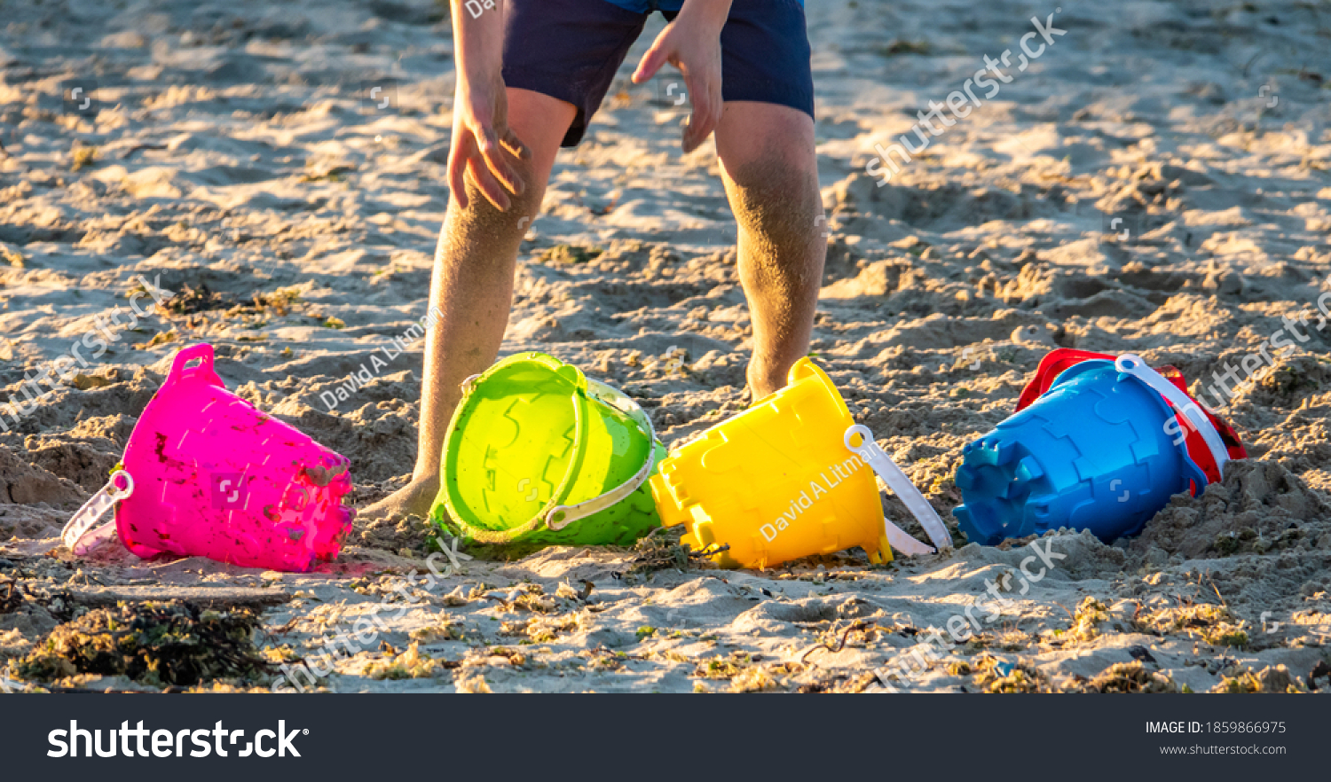 Colorful buckets for playing in the sand at the beach in Monterey, California.