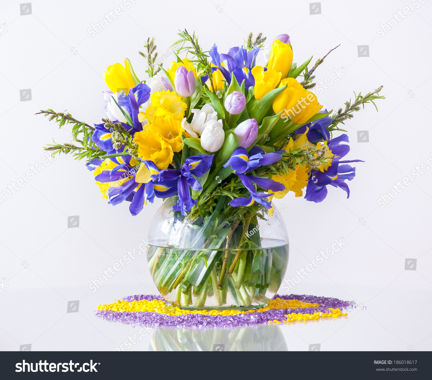 Bouquet daffodils tulips fleurdelises on white stock photo edit now bouquet of daffodils tulips and fleur de lises on white background typical spring izmirmasajfo