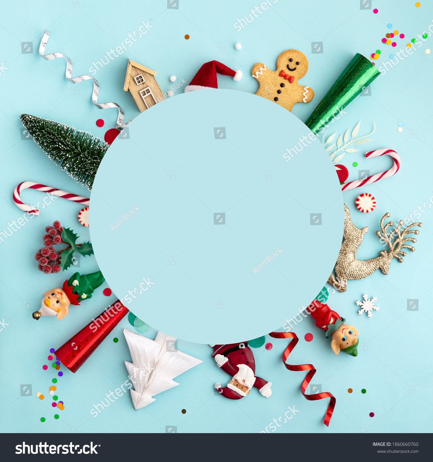 Christmas ornament flat lay background on blue, overhead view #1860660760