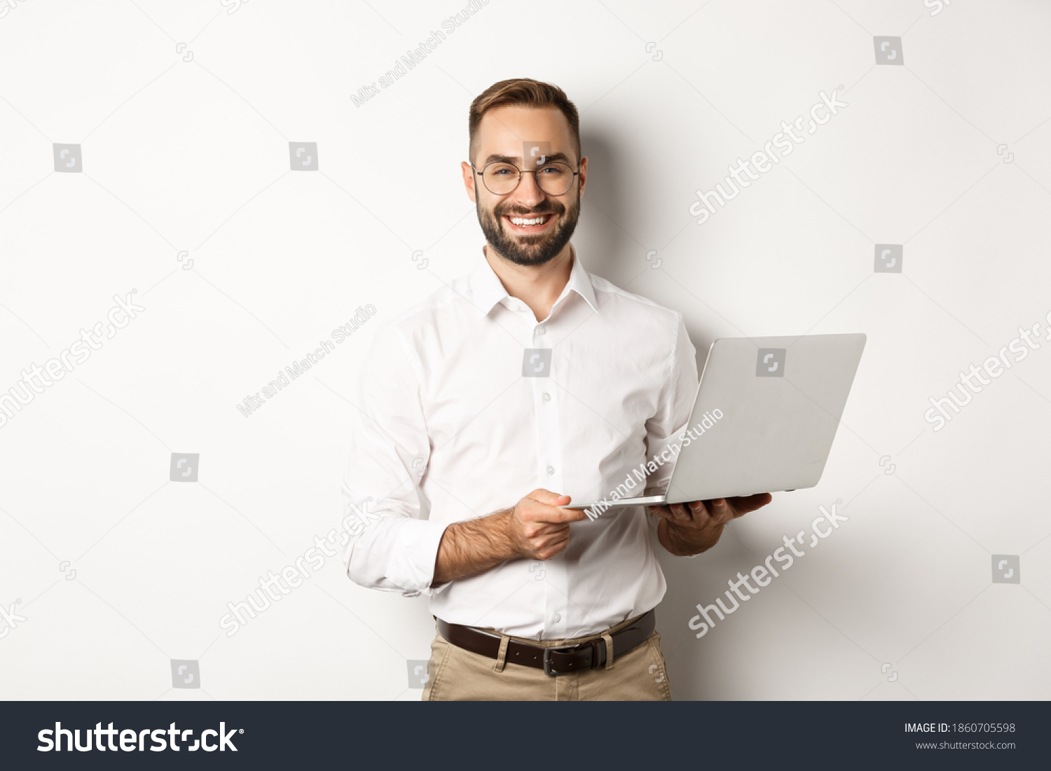 Business. Sucessful businessman working with laptop, using computer and smiling, standing over white background #1860705598