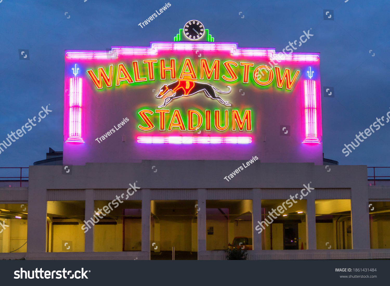 Walthamstow Dog Stadium at night with the neon lights glowing. Close up front view. London - 25th November 2020