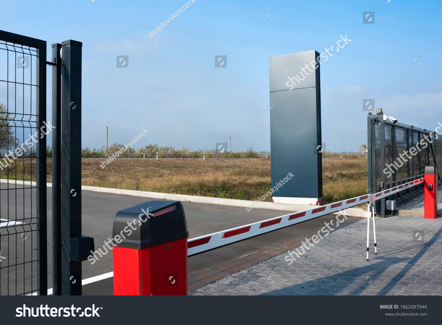 Closed automatic gate of the barrier. Automatic security system for private areas. Automatic entry system, parking barrier. #1862687944