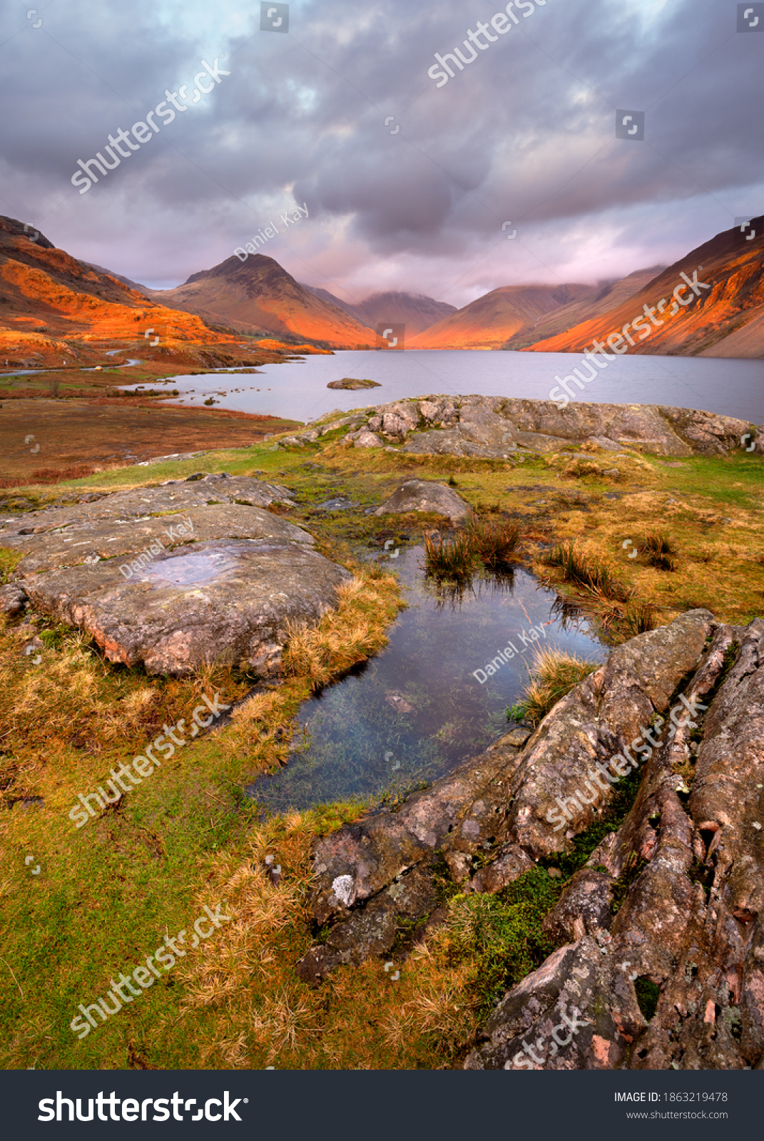 Scenic view of mountains and lake at sunset with golden light and moody clouds. Wastwater, Lake District, UK. #1863219478