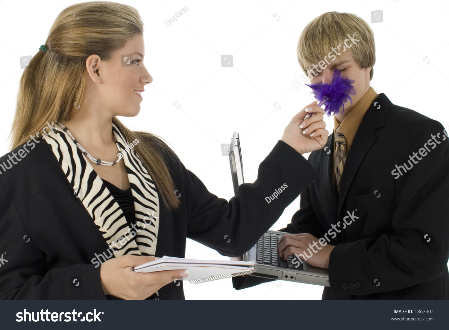 teen girl tickles teen boy feather stock photo shutterstock teen girl tickles teen boy feather pen dressed in business suits