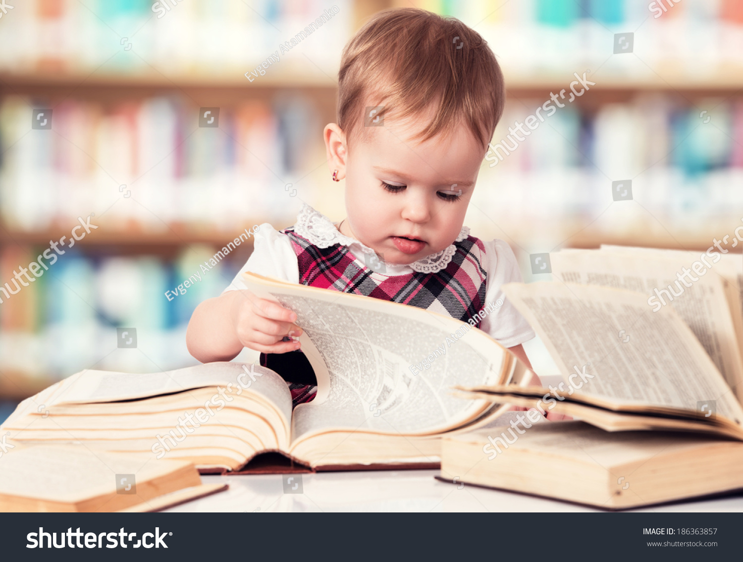 happy cute baby girl reading book stock photo (edit now)- shutterstock