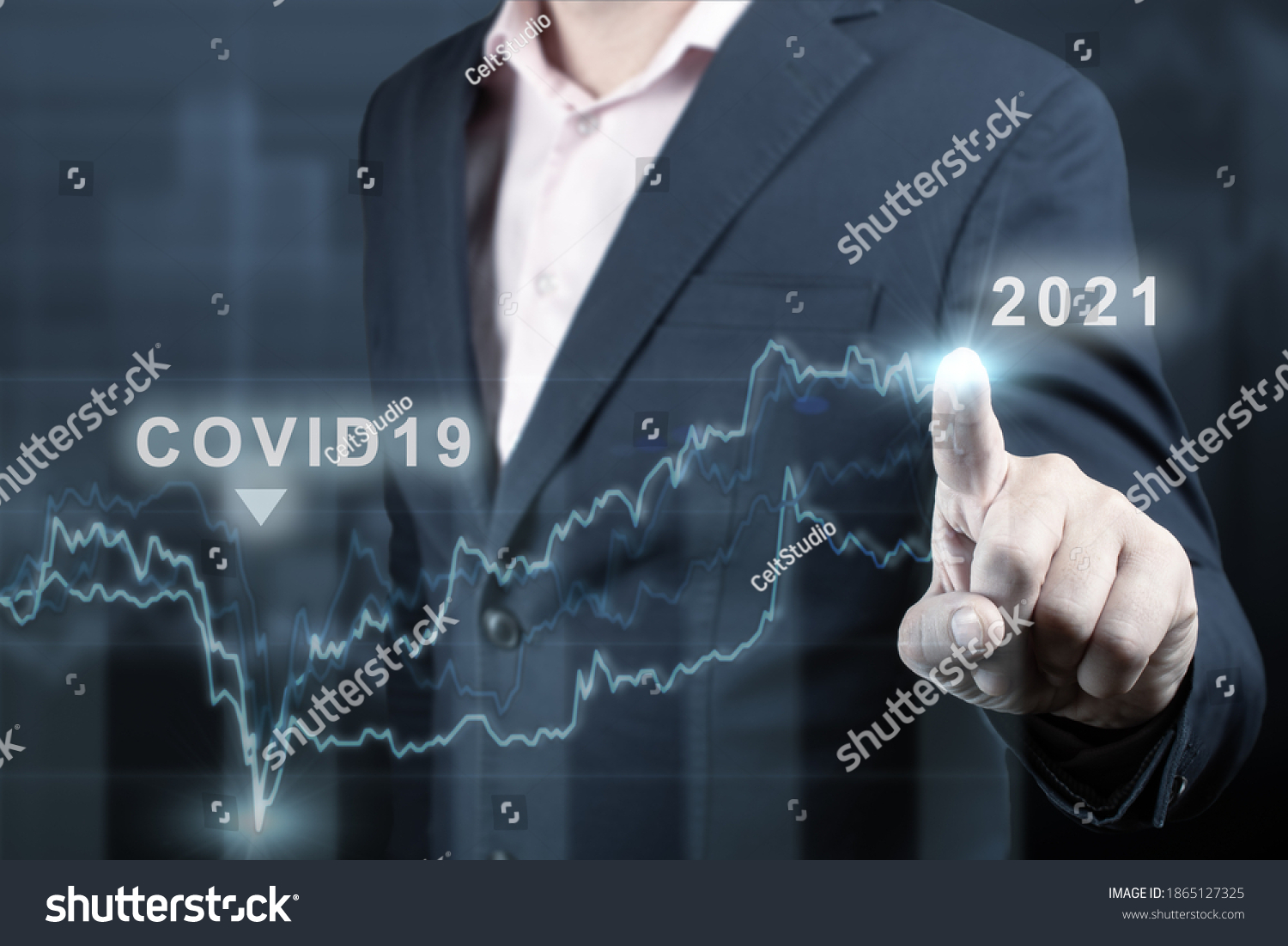 concept of economic recovery after the fall due to the covid 19 coronavirus pandemic. Double exposure of financial graph. Businessman pointing graph corporate future growth plan on dark blue #1865127325