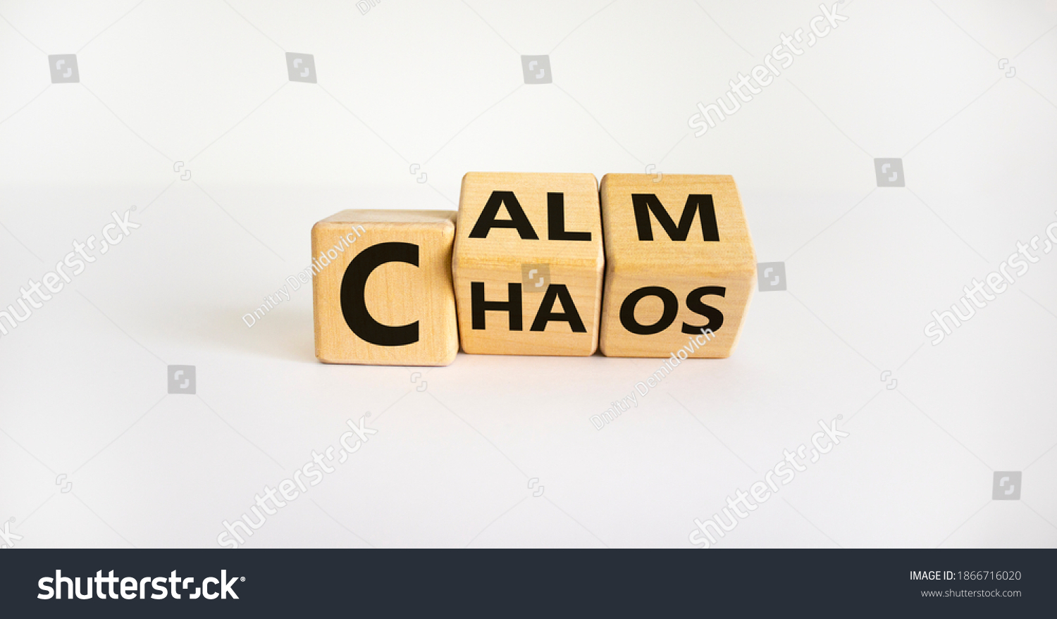 Stop chaos, time to calm. The words 'chaos' and 'calm' on wooden cubes. Beautiful white background, copy space. Business and chaos or calm concept. #1866716020
