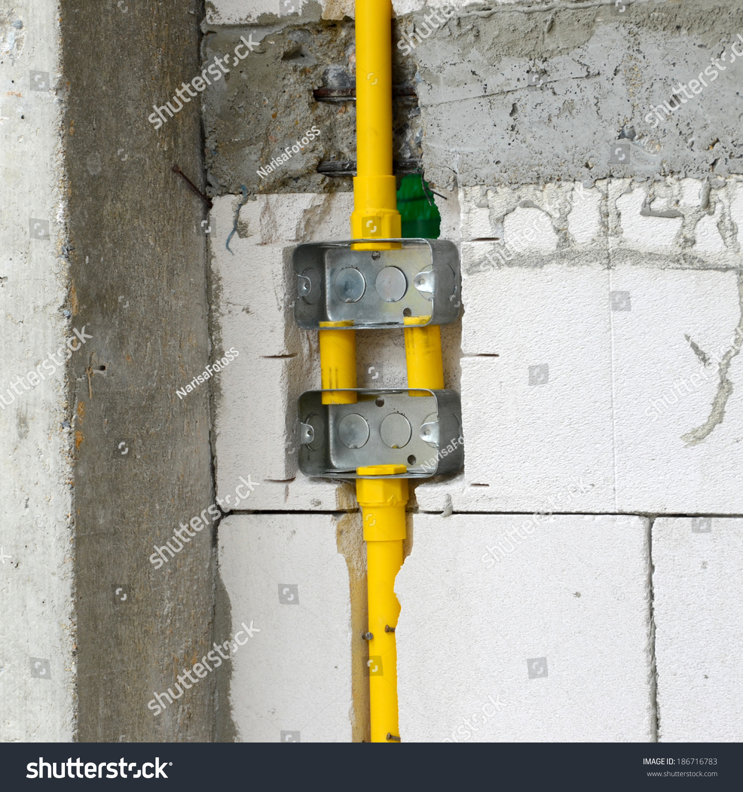 Electrical Wiring In Cinder Block Walls Trusted Diagram Wall Pvc Pipe Boxes Wires Buried Stock Photo Edit Now Through A Studded