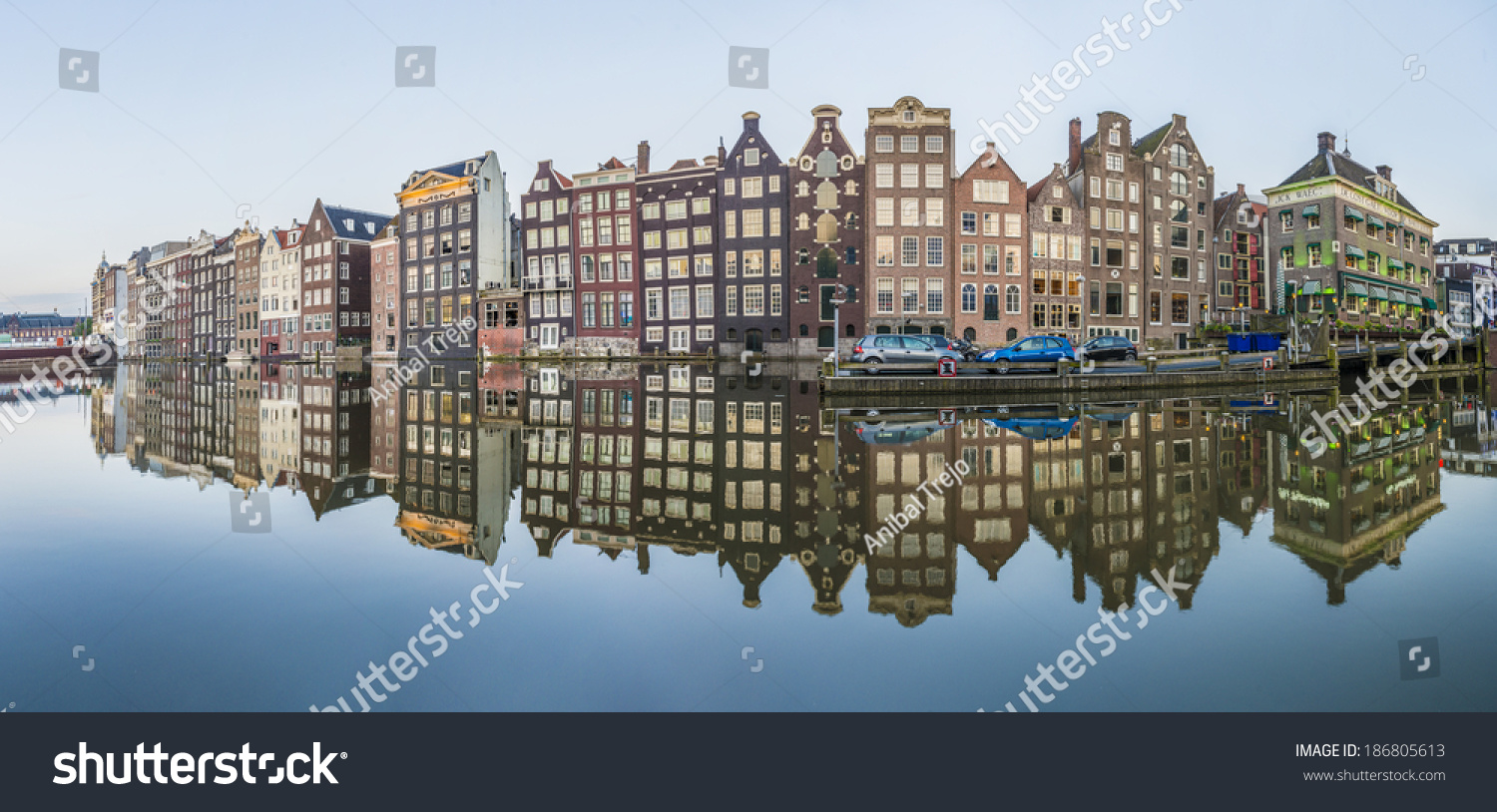 The Damrak Canal, Running Between Amsterdam Centraal In ...