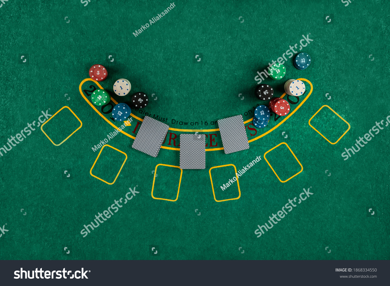 Chips cards lie on a green blackjack table top view. Casino concept, gambling #1868334550