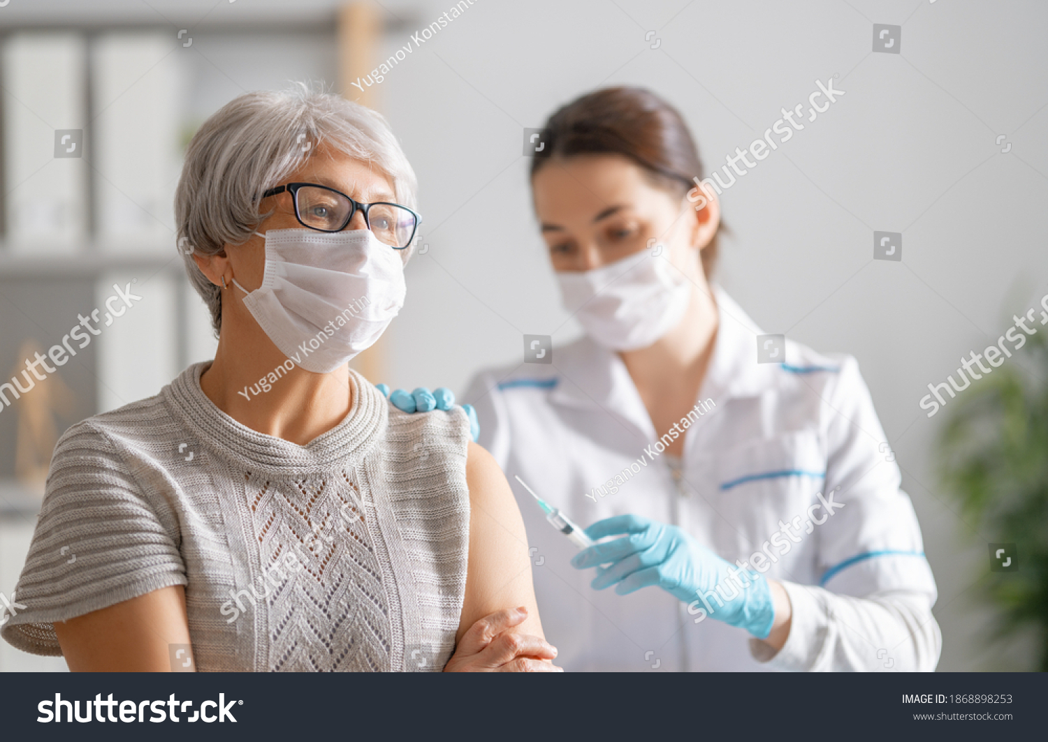 Doctor giving a senior woman a vaccination. Virus protection. COVID-2019. #1868898253