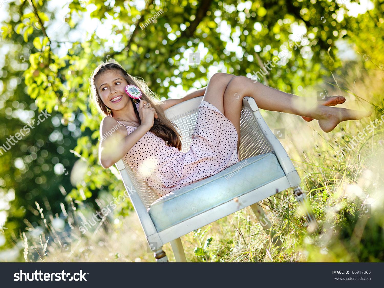 https://image.shutterstock.com/shutterstock/photos/186917366/display_1500/stock-photo-beautiful-teenage-girl-is-enjoying-leisure-time-with-lollipop-in-green-sunny-park-186917366.jpg
