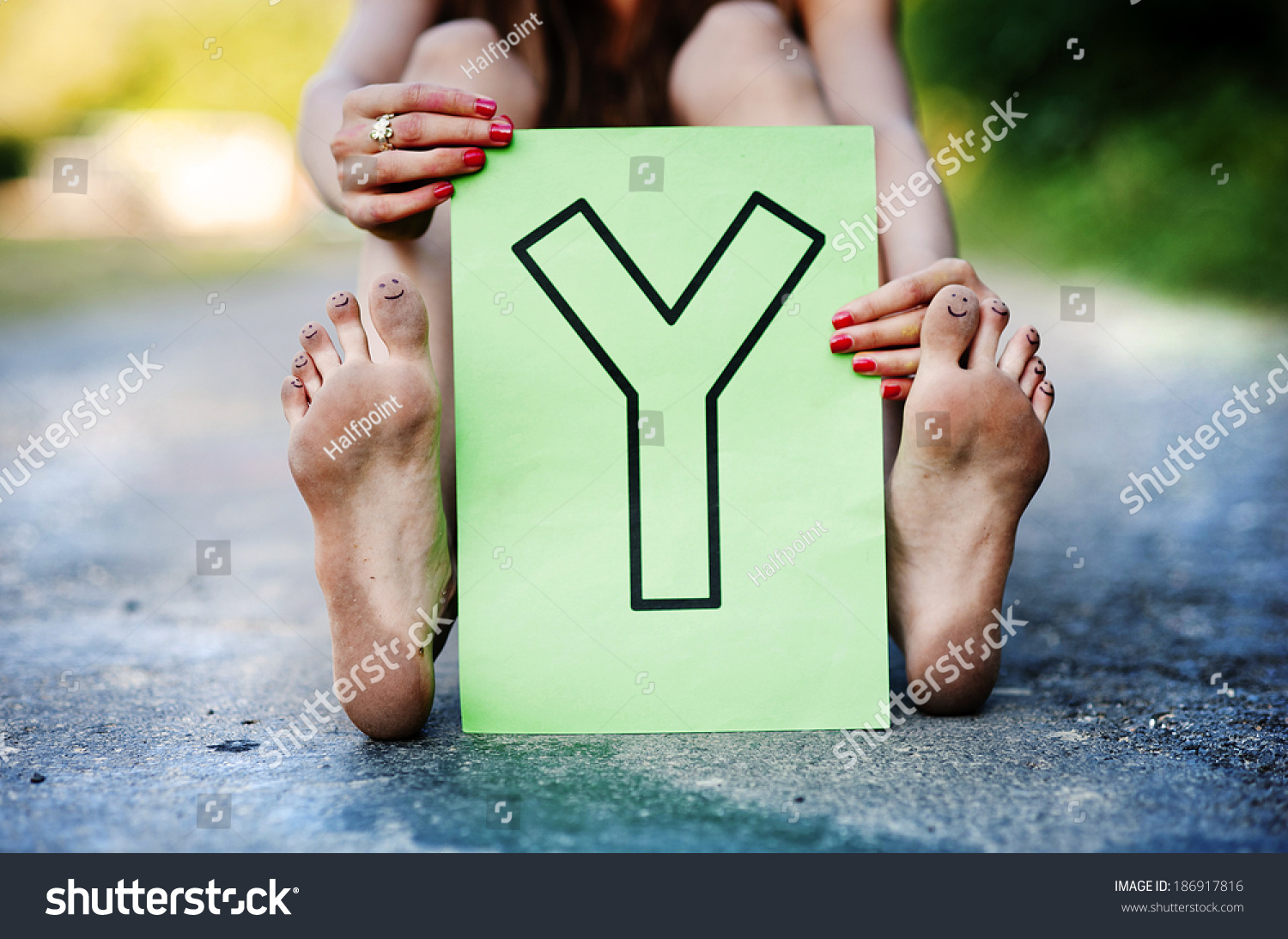 https://image.shutterstock.com/shutterstock/photos/186917816/display_1500/stock-photo-detail-of-beautiful-teenage-girl-showing-letter-y-in-green-sunny-park-186917816.jpg
