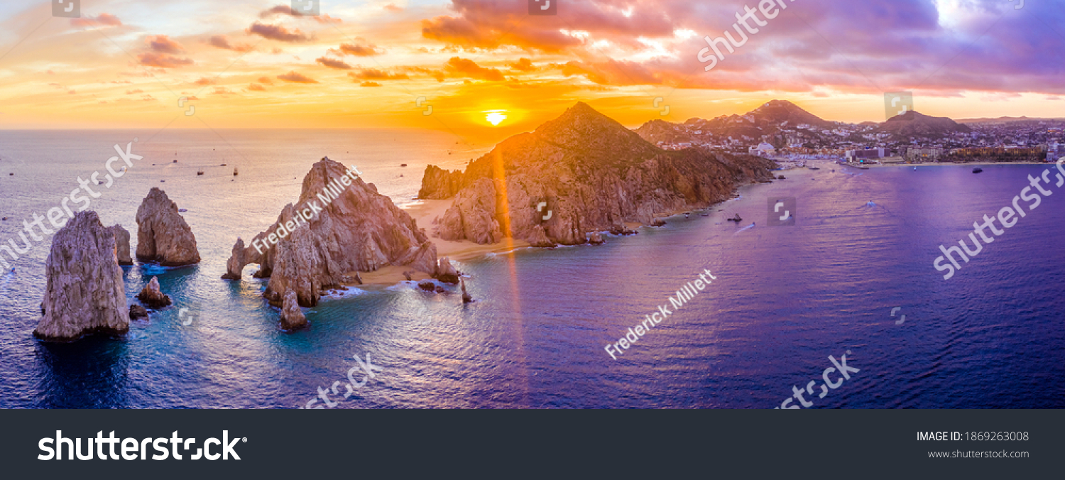 Aerial panoramic view of the Cabo San Lucas, Mexico marina and the rock formations at Lands End. the southernmost tip of the Baja California peninsula, where the Sea of Cortez meets the Pacific Ocean #1869263008