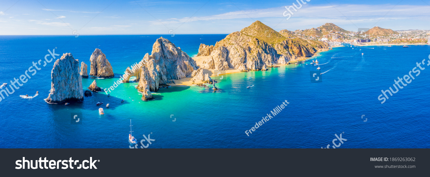 Aerial panoramic view of Lands End and El Arco at the tip of Baja California Sur, with the Cabo San Lucas, Mexico marina in the background #1869263062