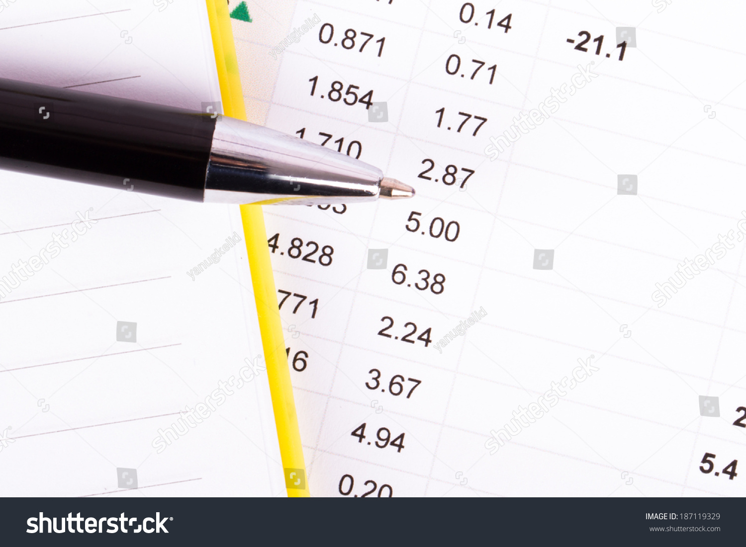 Financial Data Analysis With Notebook And Pen, Top View.