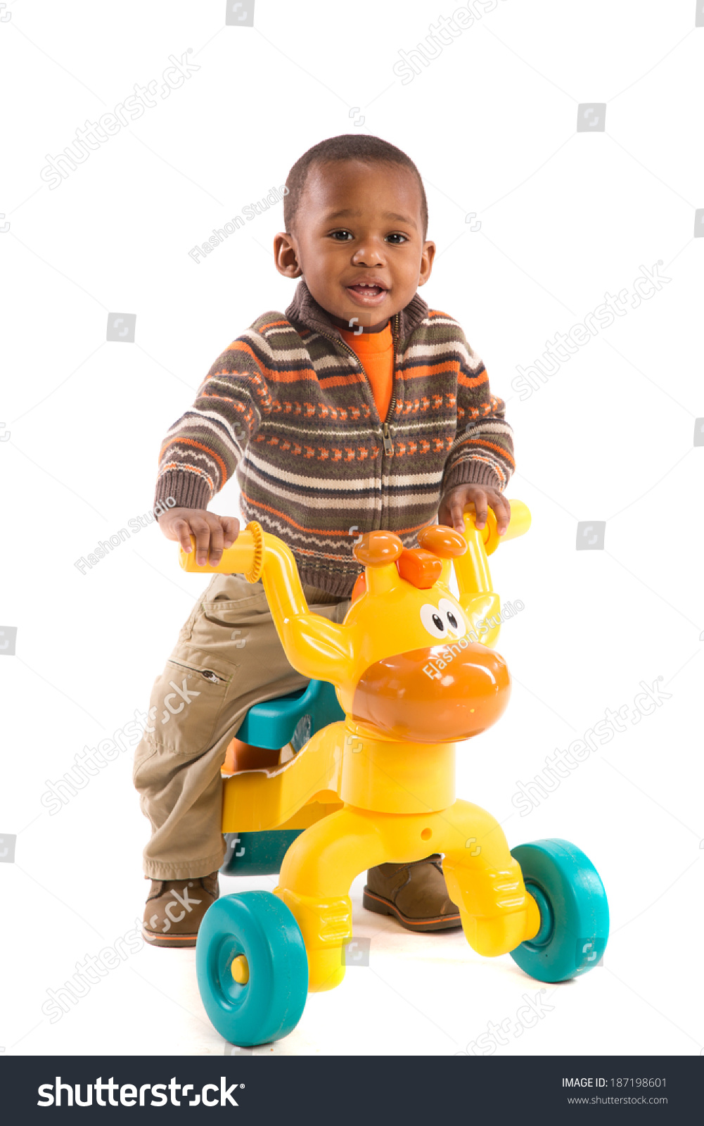 One Year Old Riding Toys : One year old boy riding toy tricycles isolated on white