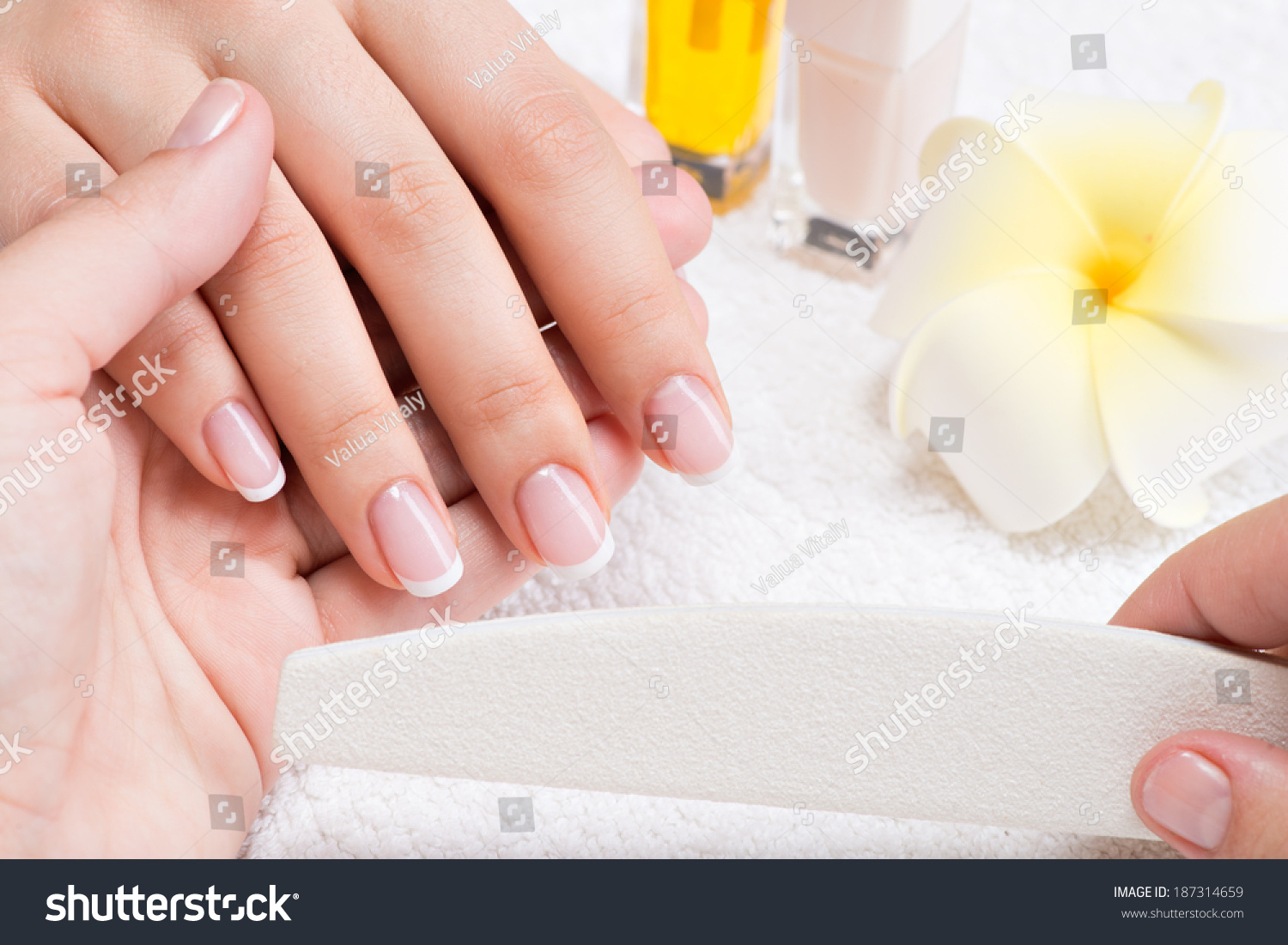 Woman nail salon receiving manicure by stock photo for A trial beauty treatment salon