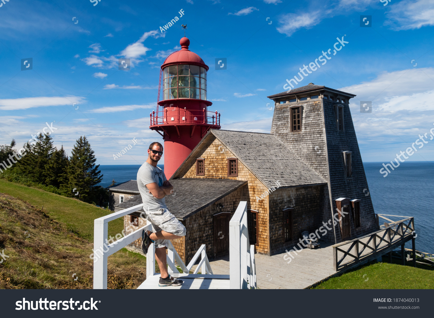 stock-photo-young-man-posing-in-front-of