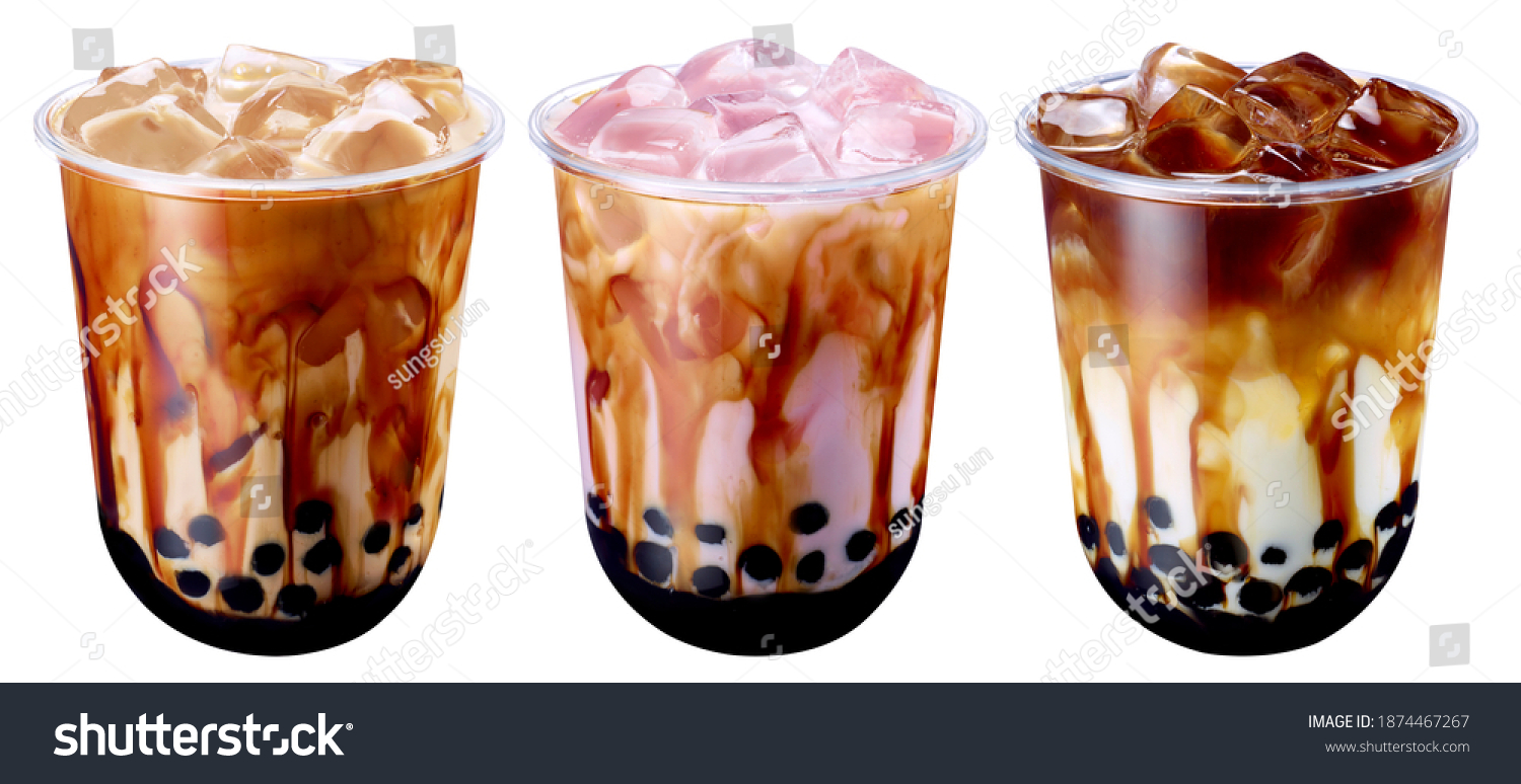 Bubble Milk Tea - A plastic glass of fresh milk with black sugar syrup (Kuromitsu) and hot black pearl (Boba) on White Background, Taiwanese drinking culture #1874467267
