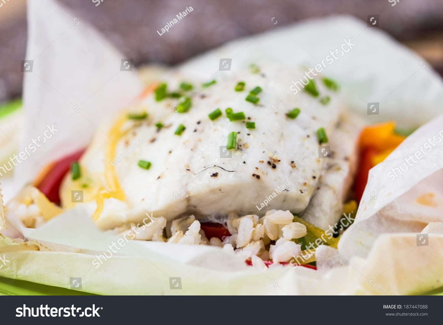 White fish fillet baked paper parchment stock photo for Fish and rice diet