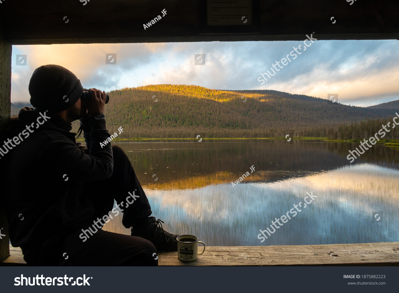 stock-photo-man-looking-through-binocula