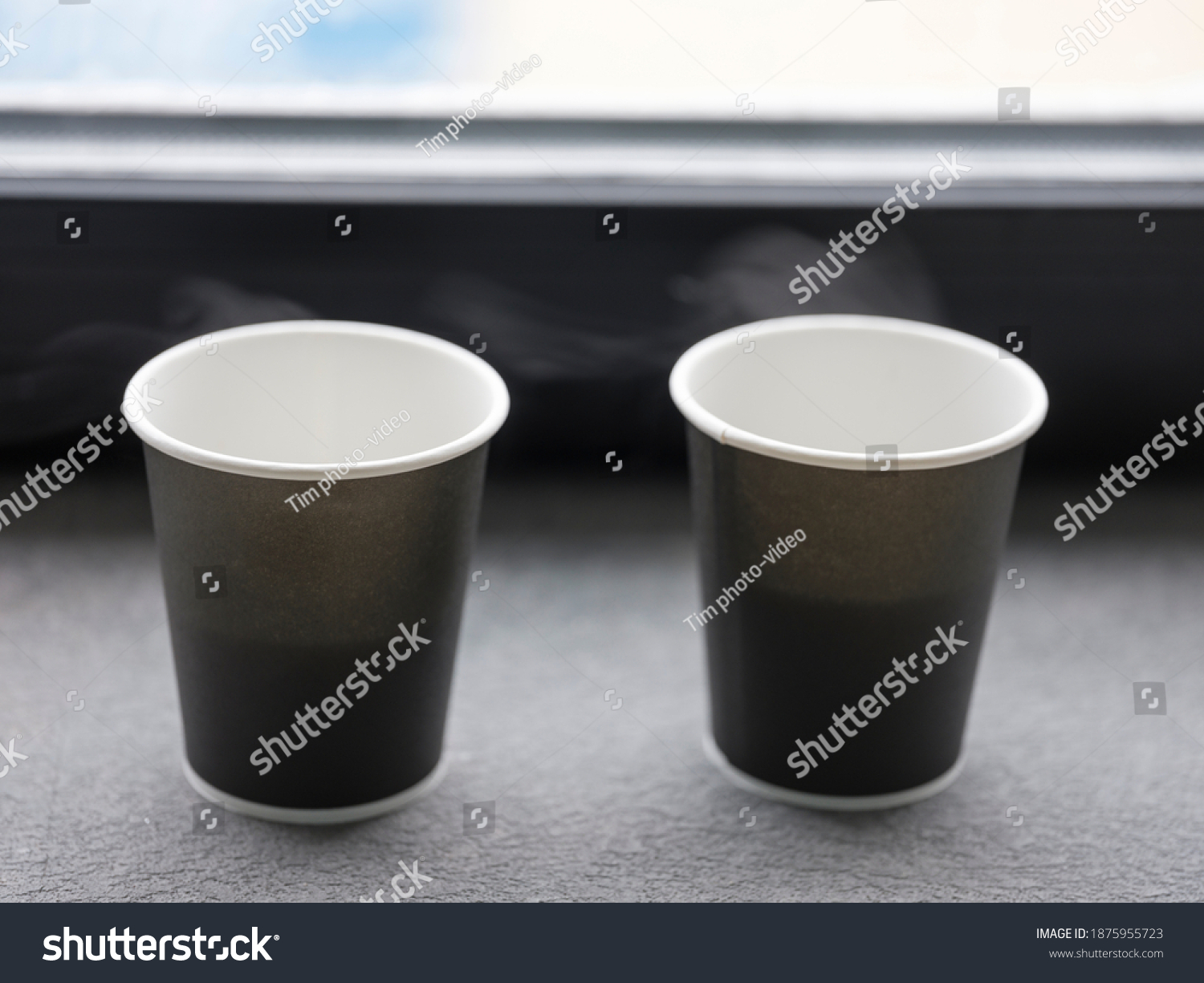 stock-photo-two-disposable-paper-cups-on