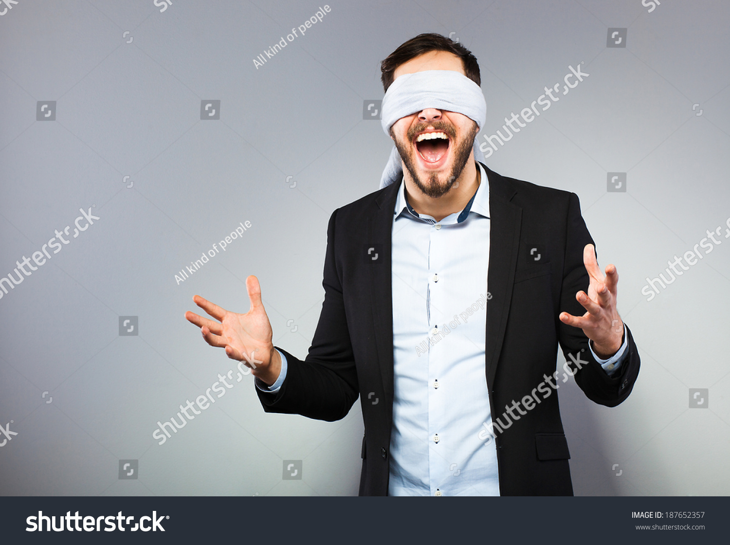 stock-photo-excited-blindfolded-man-in-b