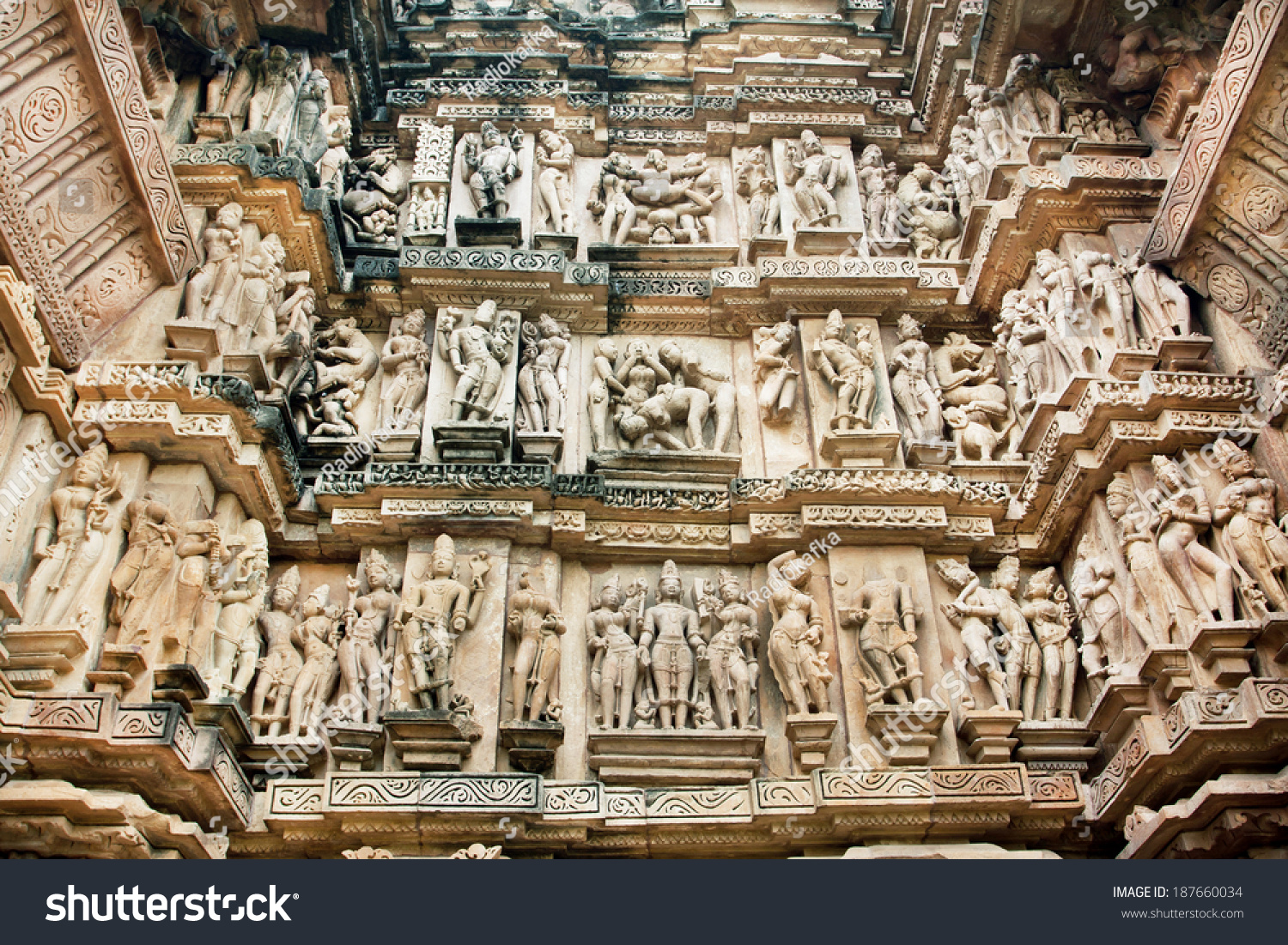 Sex positions and peoples life on the wall with sculptures of famouse  Khajuraho temples. Holy