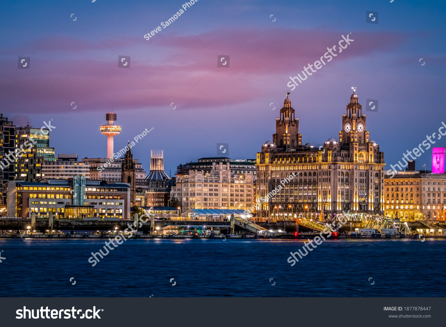 Liverpool waterfront illuminated at dusk