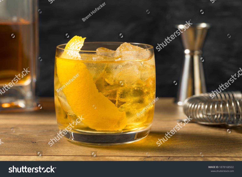 Boozy Refreshing Rusty Nail Cocktail with Lemon Garnish #1878168502