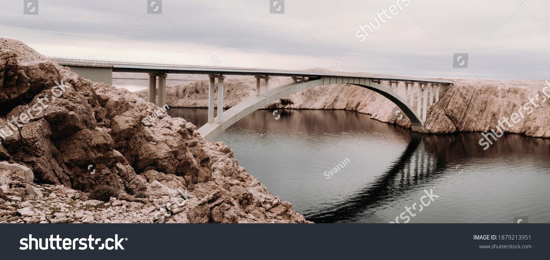 https://image.shutterstock.com/z/stock-photo-panoramic-shot-of-pag-bridge-in-croatia-1879213951.jpg