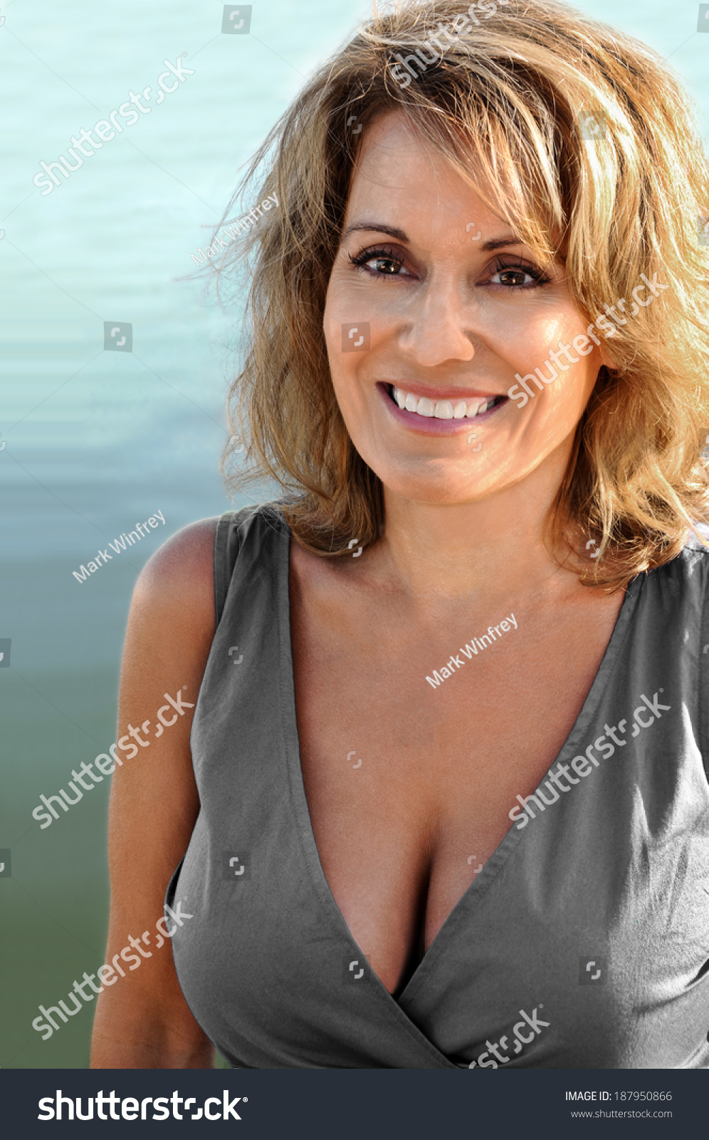 pretty mature woman wearing grey summer stock photo (100% legal