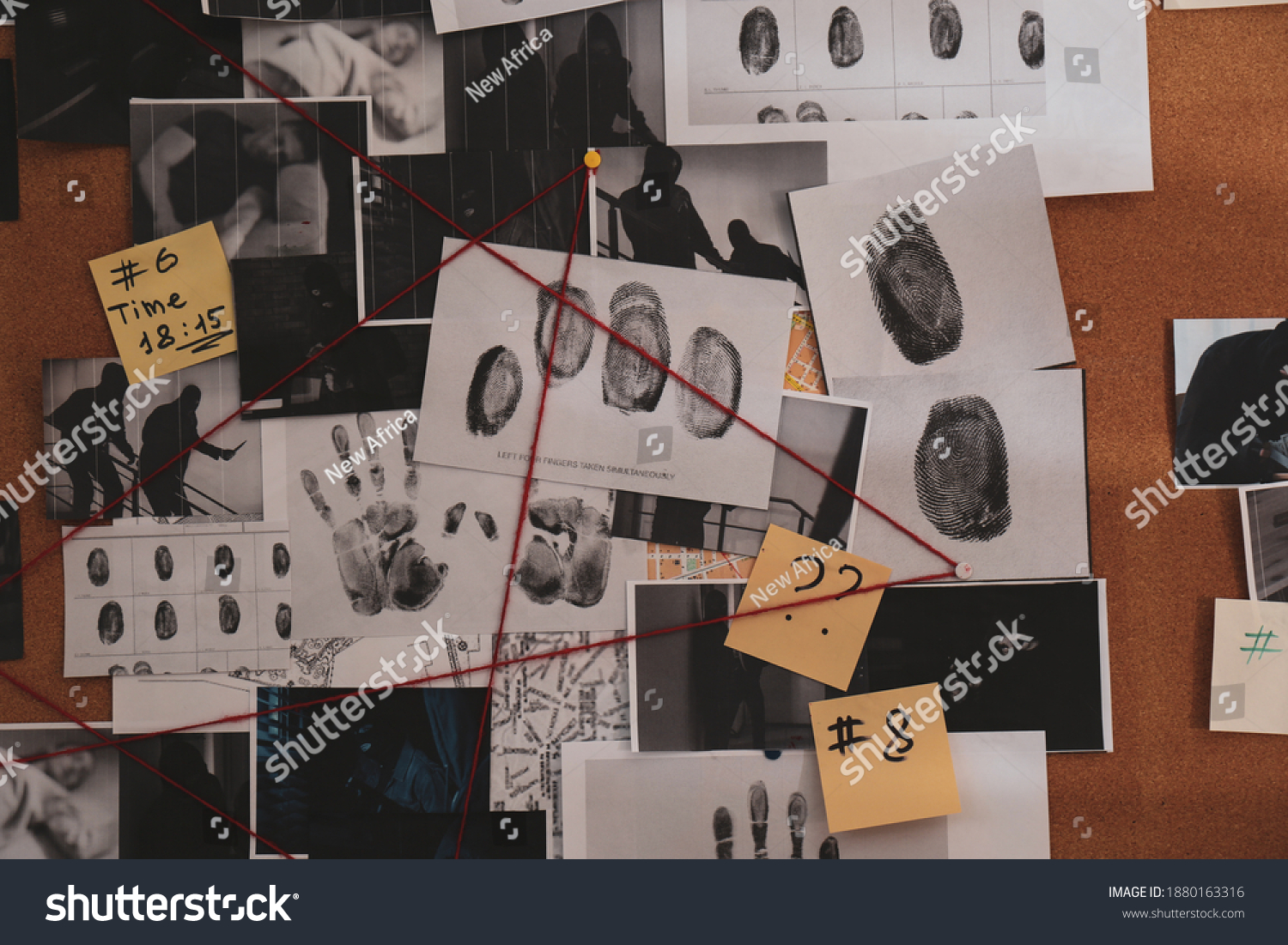 Detective board with crime scene photos, stickers, clues and red thread, closeup #1880163316