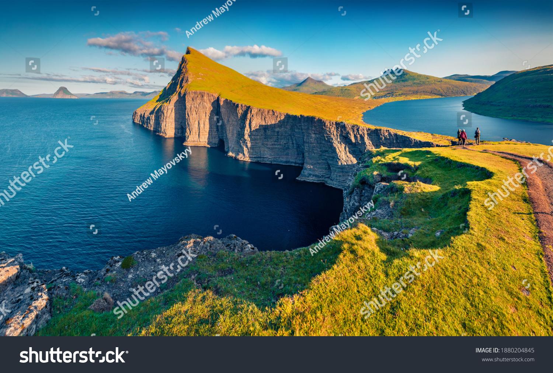 Trekking to Sorvagsvatn lake, Vagar, Faroe Islands, Denmark, Europe. Unbelievable summer seascape of Atlantic Ocean. Aerial landscape photography. Beauty of nature concept background. #1880204845