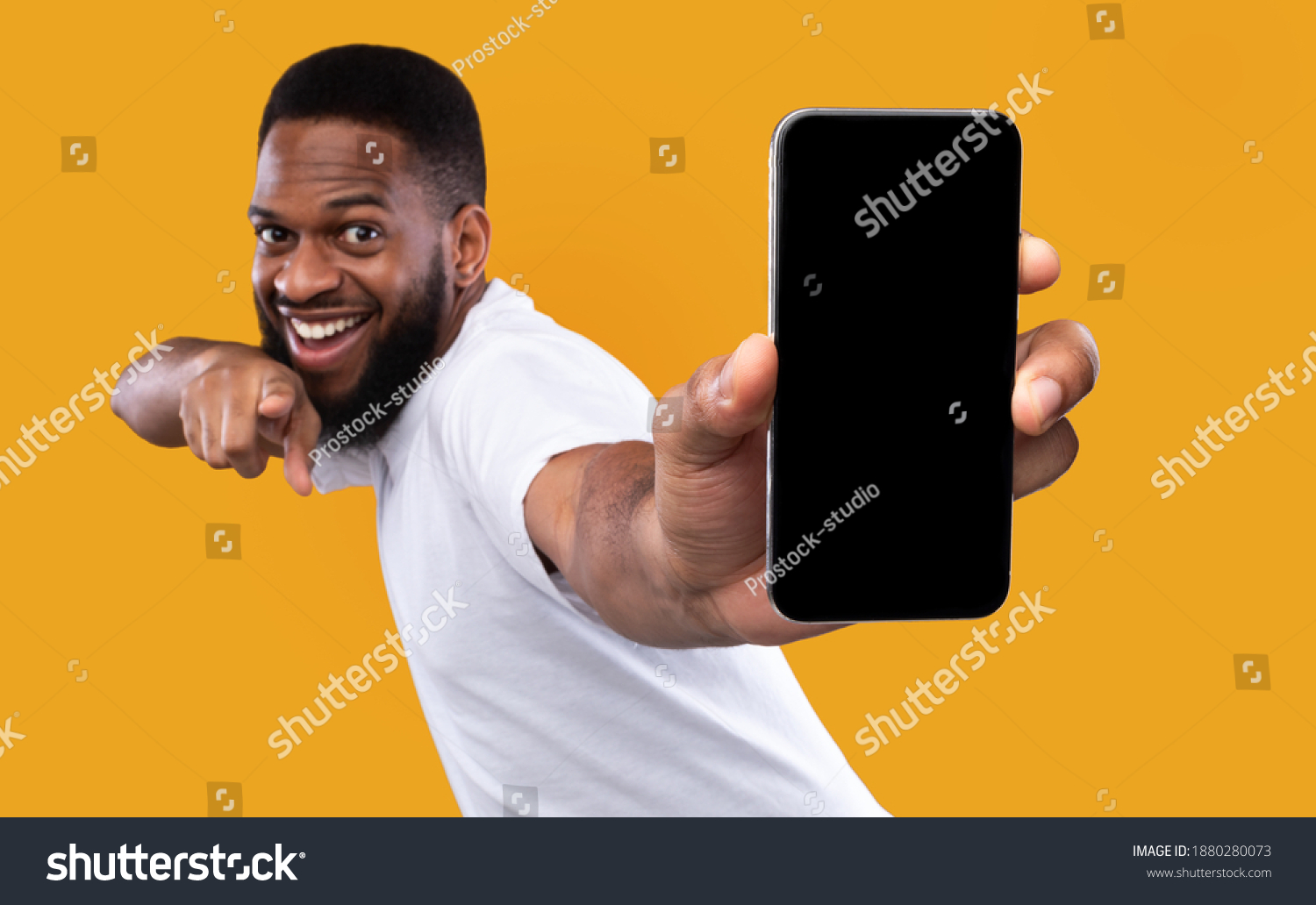 Mobile App Advertisement. Excited Black Man Showing Smartphone Empty Screen Recommending App Posing Over Yellow Studio Background, Smiling To Camera. Check This Out, Cellphone Display Mockup #1880280073