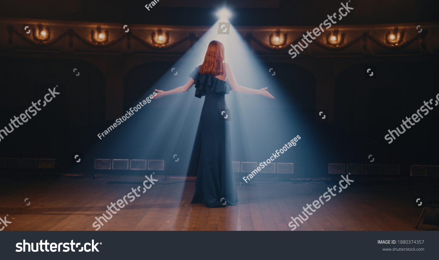 Young woman in elegant dress gesticulating and talking passionately with audience then walking away in end of performance in theater #1880374357