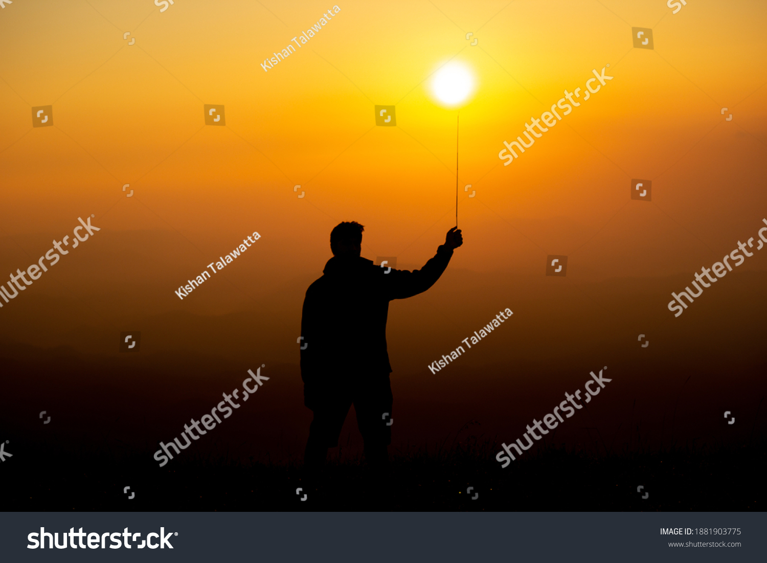 stock-photo-silhouette-of-boy-playing-wi