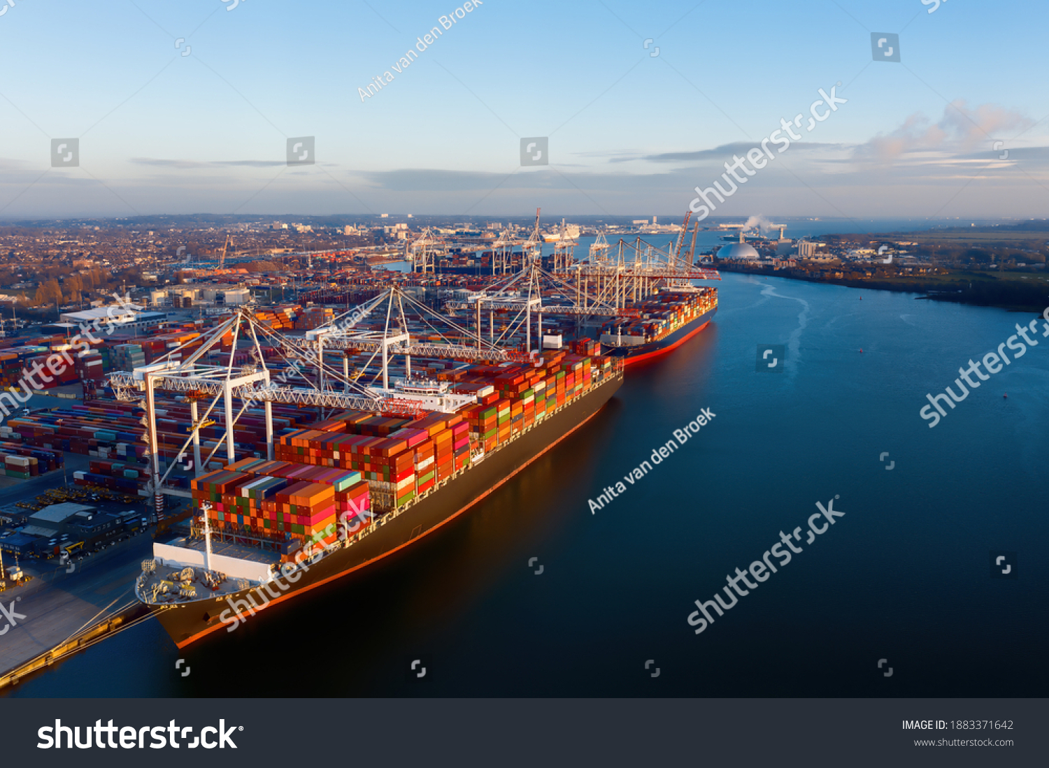 Aerial view of colorful containers on cargo ships at the port of Southampton, which is one of the Leading Port Terminal Operators in the UK. Containers on the dock too. Space for text. #1883371642