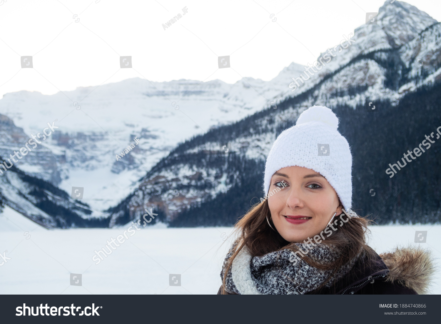 Portrait of a young woman posing at Lake Louise, in the Banff national park, Canada
