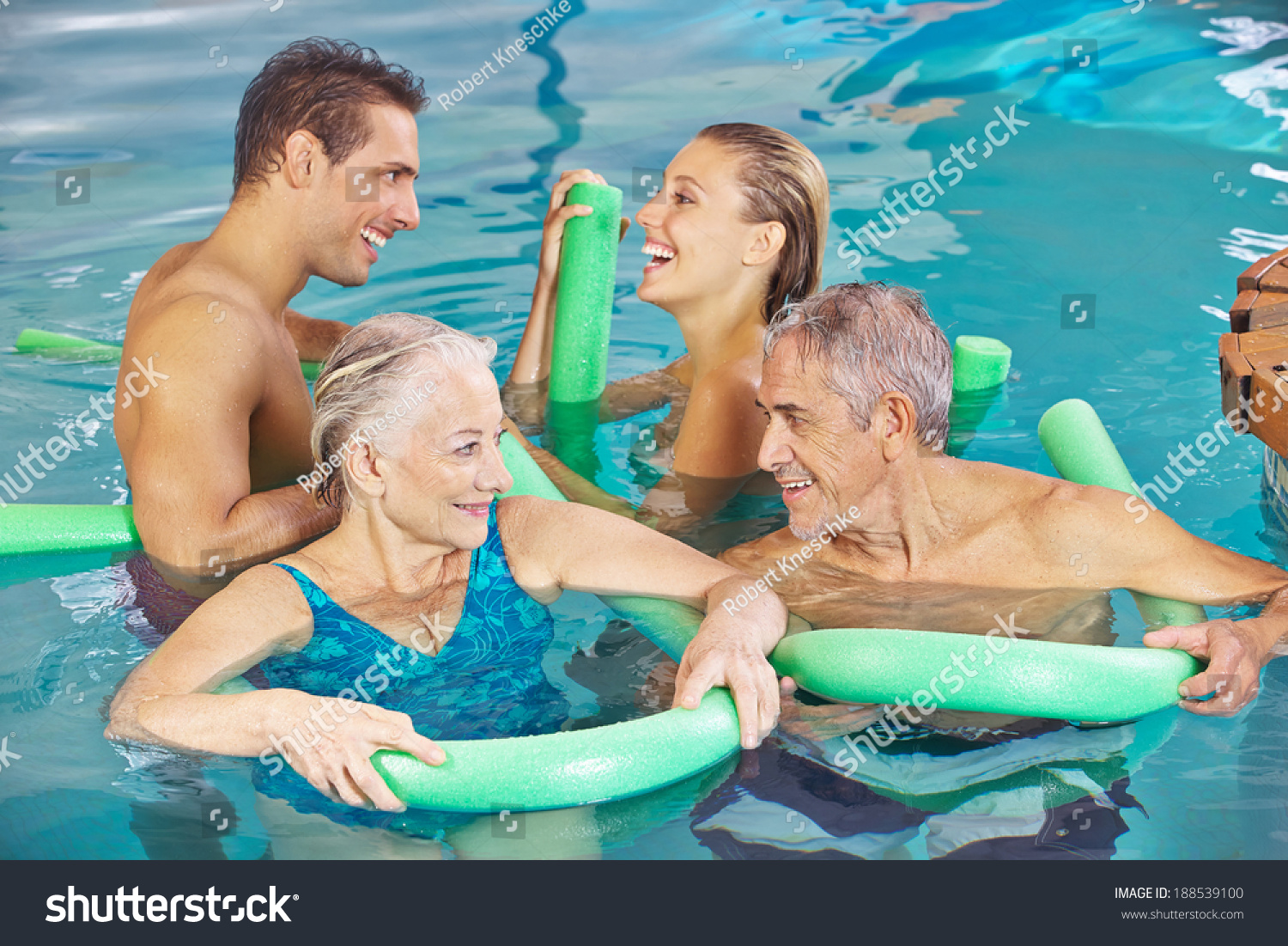 Happy group in swimming pool doing aqua fitness with swim Fitzroy swimming pool group fitness
