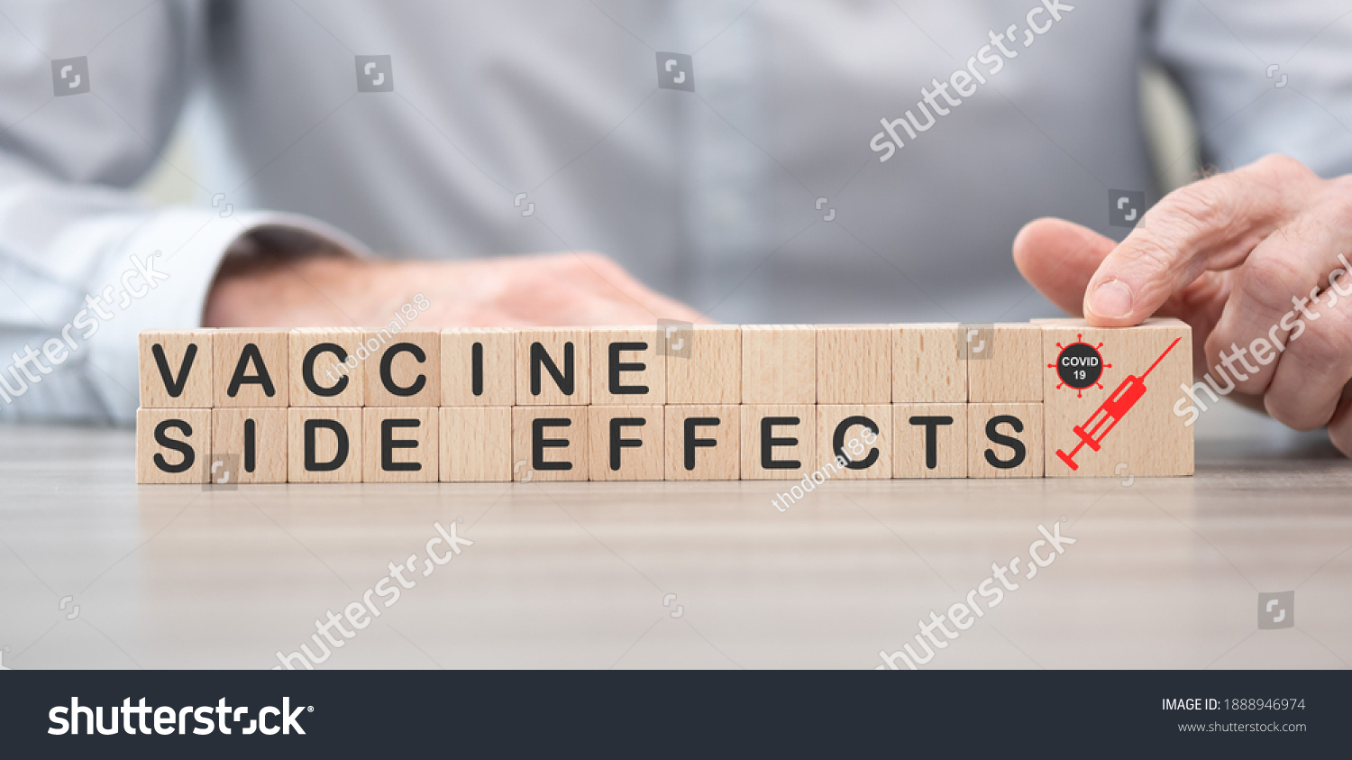 Concept of Covid-19 vaccine side effects on wooden cubes #1888946974