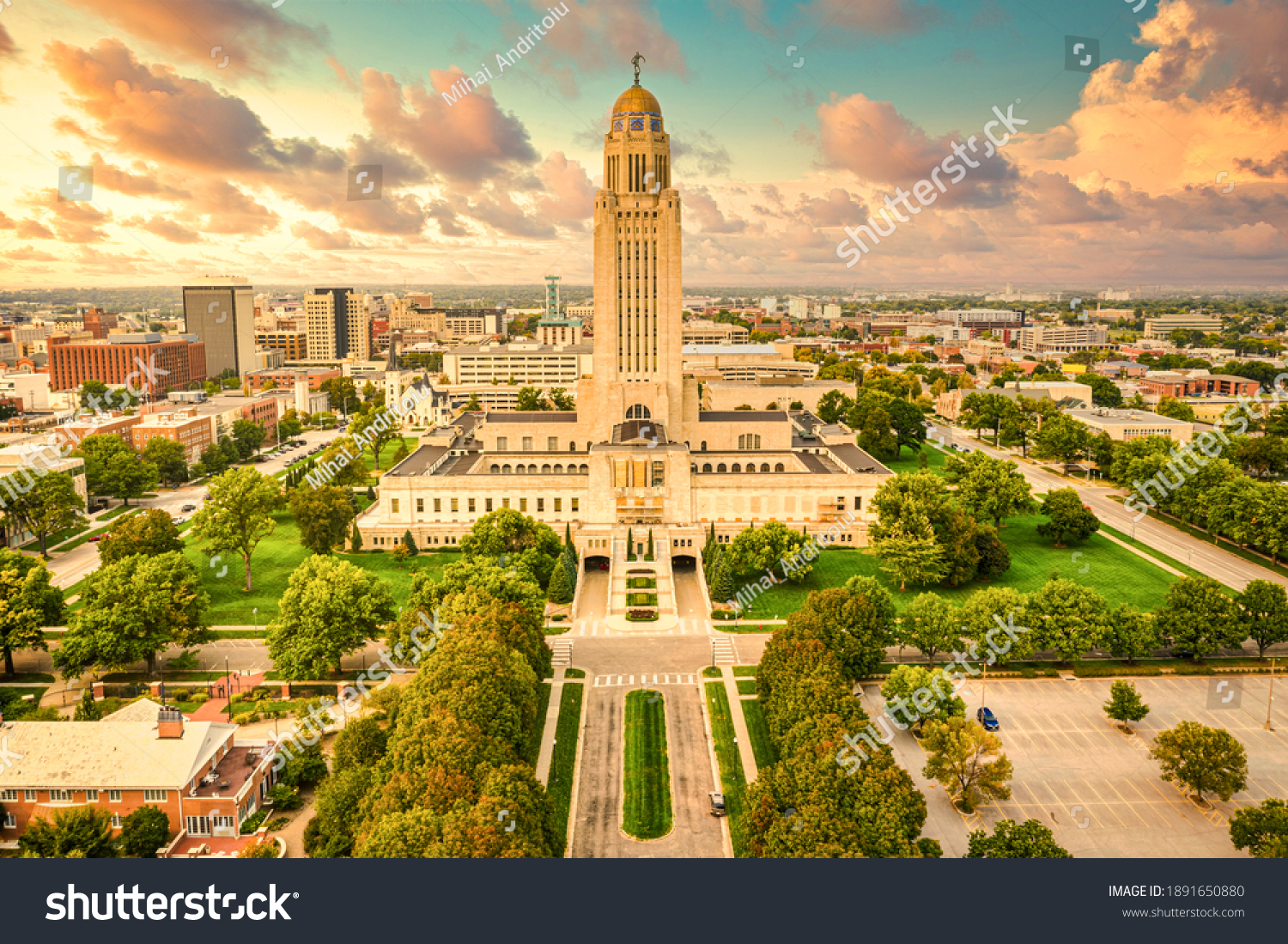 Lincoln skyline and Nebraska State Capitol. The Nebraska State Capitol is the seat of government for the U.S. state of Nebraska and is located in downtown Lincoln. #1891650880