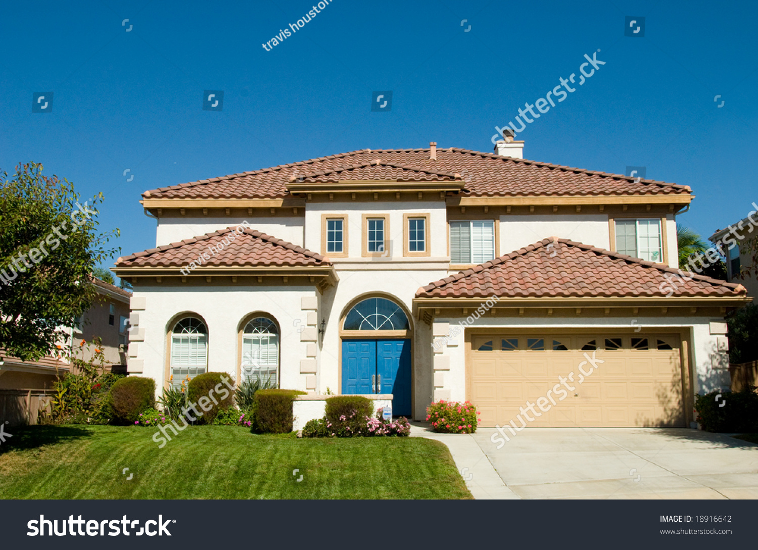 Spanish style contemporary house with green grass yard and for Modern spanish style homes