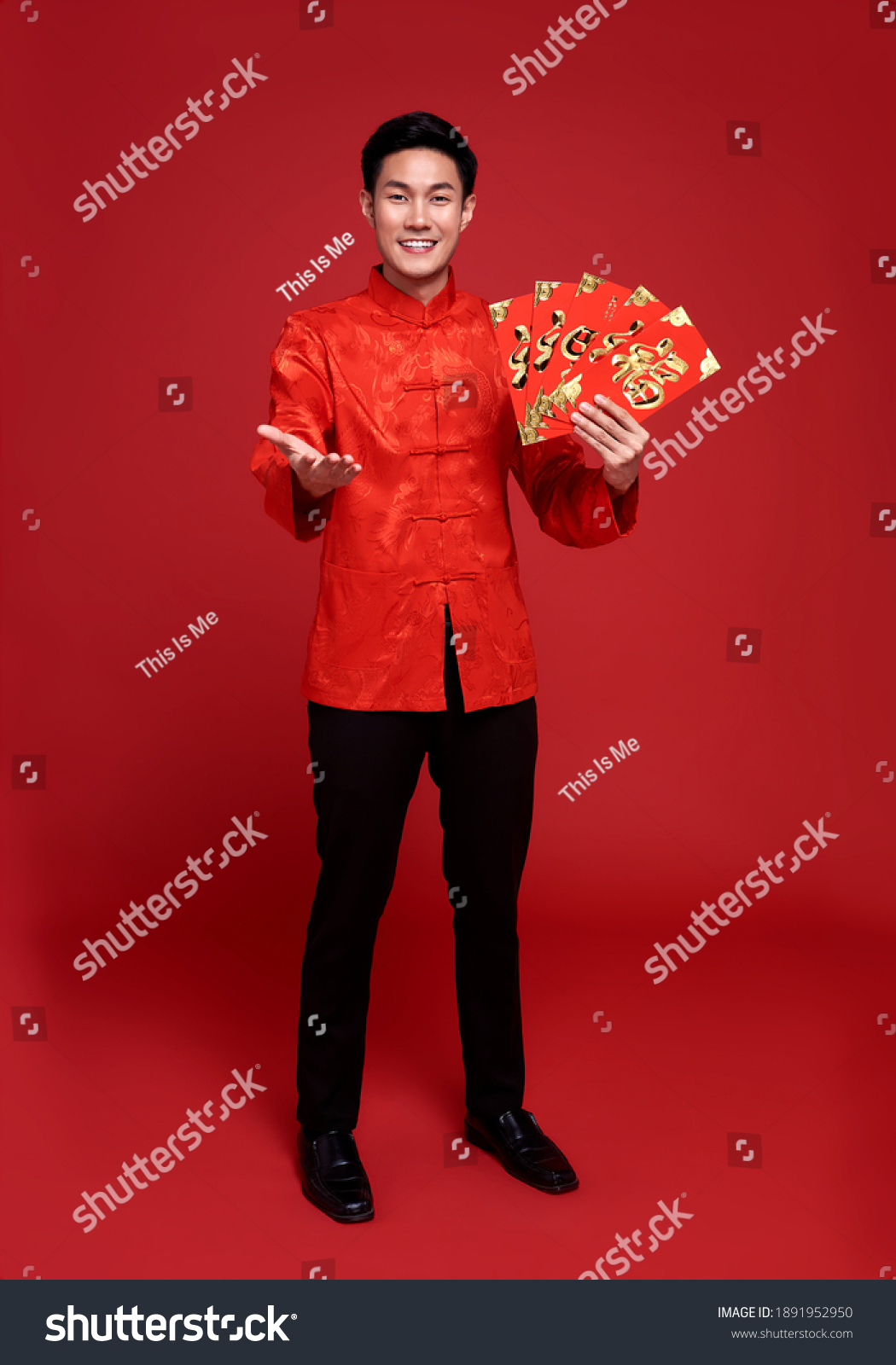 """Happy Chinese new year. Asian man holding angpao or red packet This word means """"happiness"""".monetary gift isolated on red background. #1891952950"""