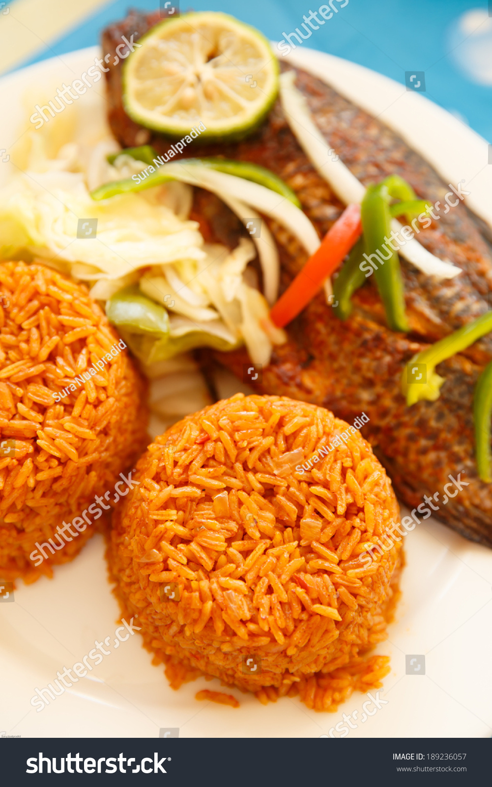 One of most popular food in ghana jollof rice serve with for What to serve with fish